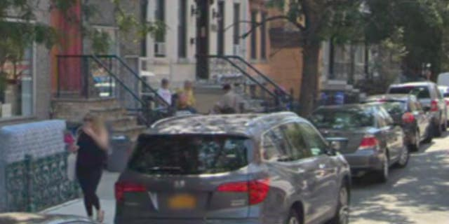 Bystanders can be seen in the footage watching the scene unfold down the block.
