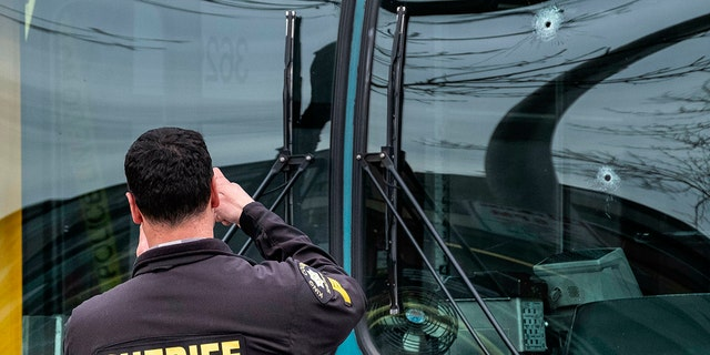 Bullet holes can be seen in the driver's side window of a Metro Bus in Seattle after a shooting, Wednesday, March 27, 2019. (Associated Press)