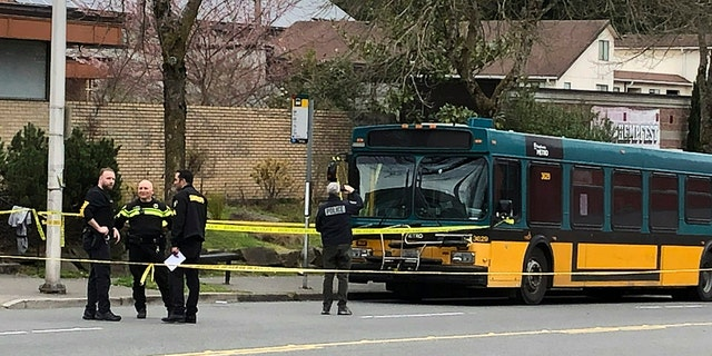 Investigators work at the scene of a shooting in Seattle on Wednesday, March 27, 2019. (Associated Press)