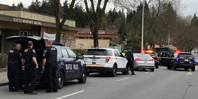 Seattle police are working on stage for a shoot in Seattle on Wednesday. (Associated Press)