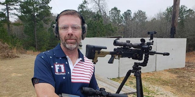 """David Smith, a pro shooter with Parkinson's Disease, has developed what he called """"gun therapy."""""""