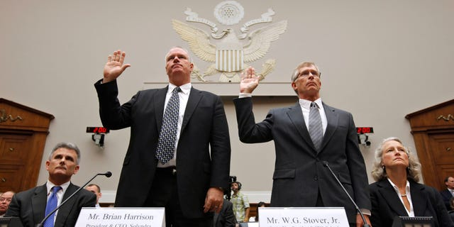 Solyndra CEO Brian Harrison. left, and Chief Financial Officer Bill Stover, right, testified to House lawmakers in September 2011. Attorneys Walter Brown is at left, and Jan. Nielsen Little is at right in this photo. (AP Photo/J. Scott Applewhite, File)