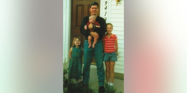 """Johnny """"Mike"""" Spann with his three children"""