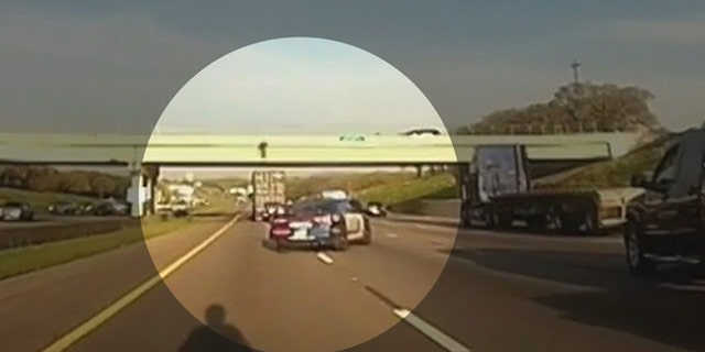 A police officer in Texas directed a semi-truck to under an overpass on Interstate 20 where a teenager was threatening to jump.