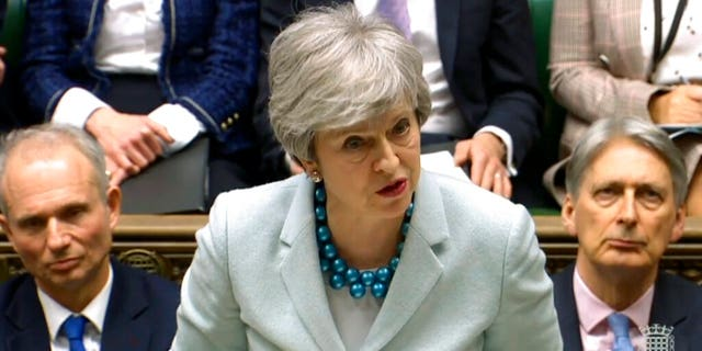 Britain's Prime Minister Theresa May makes a statement on Brexit to lawmakers in the House of Commons, London, Monday March 25, 2019. May is under intense pressure Monday to win support for her Brexit deal to split from Europe.
