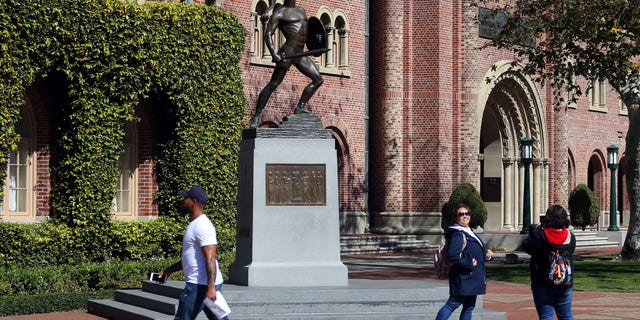 The University of Southern California said in a statement she noted in those students' reports that it prevents them from doing so