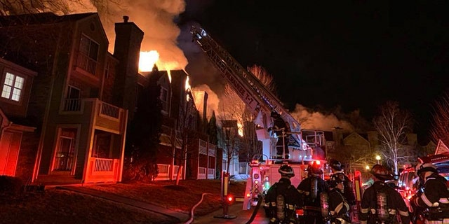 """A Wisconsin apartment building reportedly became engulfed in flames in an overnight blaze and the fire chief said it was """"miraculous"""" that all of its occupants are accounted for."""
