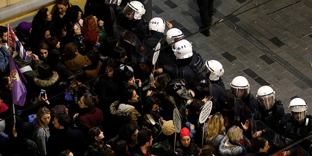 Turkish police block protesters wanting to hold a march for the International Women's Day, in Istanbul, Friday, March 8, 2019. The day has been sponsored by the United Nations since 1975 as millions around the world are demanding equality amid a persistent salary gap, violence and widespread inequality. (AP Photo/Emrah Gurel)