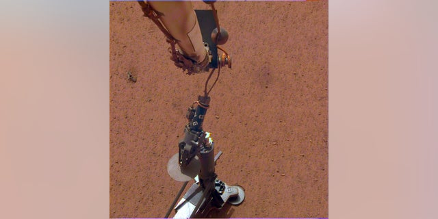 NASA's InSight lander deploys its heat probe on Mars on Feb. 12, 2019.