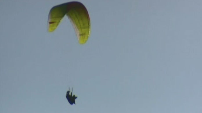 Hikers call 911 after capturing video of paraglider falling toward ground