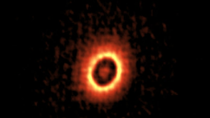 Footprints of forming planets spotted around young star