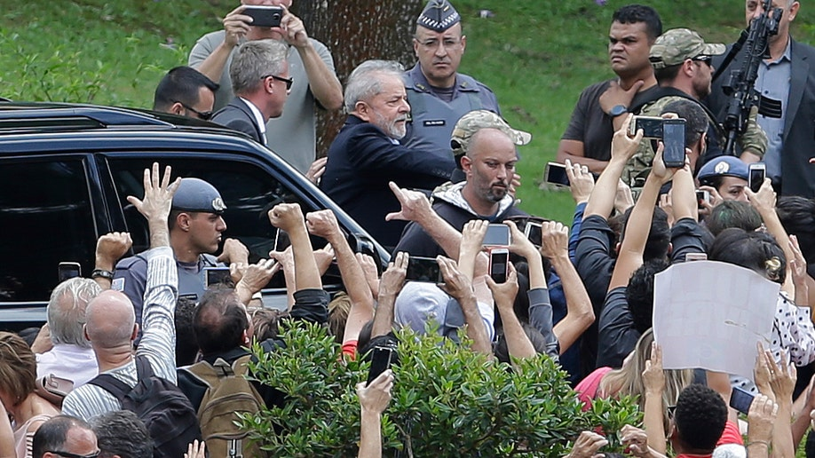 Brazil's Lula again proclaims innocence at grandson's funeral