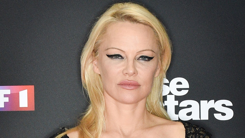 Pamela Anderson posts nearly naked throwback swimsuit photo