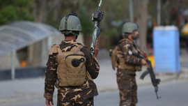Afghan official says Taliban ambush police convoy, kills 9
