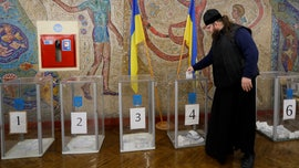 Ukrainian presidential election begins, surveys show comedian candidate leading the polls