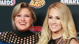 Kelly Clarkson addresses Carrie Underwood 'feud' rumors, claps back at tabloid with hilarious reply