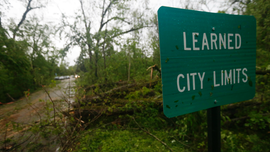 The Latest: Storm system sets rainfall record in Little Rock