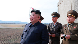 Analysis: Kim, returning to military optics, turns up heat