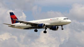 Delta plane's exterior 'crumpled' during hard landing