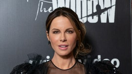 Kate Beckinsale poses in sultry bikini to show off hilarious, bizarre furniture for her cat
