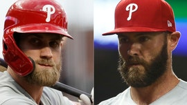 Philadelphia Phillies' Jake Arrieta chides teammate Bryce Harper after ejection