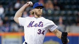 New York Mets' Noah Syndergaard under fire after video appears to show him rubbing fingers on glove