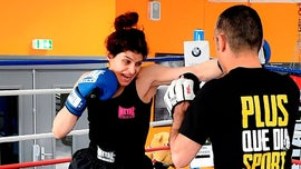 Iranian female boxing pioneer staying in France after arrest warrant issued in Tehran, rep says