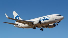 Airline passengers open emergency exit on Utair flight after seeing flames coming from engine