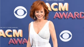 Reba McEntire walks CMAs red carpet after confirming break up