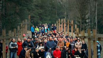 Belarus officials demolish crosses placed in memory of Stalin's Soviet terror victims