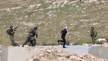 Handcuffed, blindfolded Palestinian teenager says he was shot twice by Israeli soldier while running away
