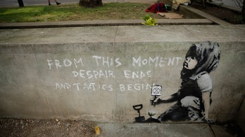 Possible Banksy artwork appears near London climate change protest