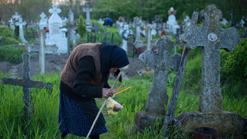 Romanian villagers light graveyard fires in Easter ritual