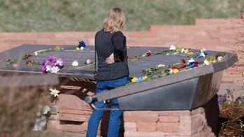 The Latest: Visitors pay respects at Columbine memorial