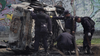 2 police wounded by bomb in car in El Salvador's capital