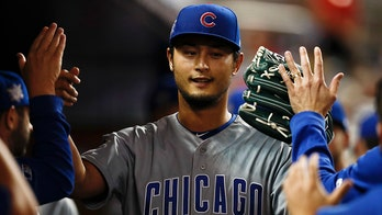 Yu Darvish's fastball pinballs off Miami Marlins batter, Cubs catcher and home plate umpire
