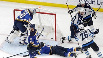 Connor scores in OT as Jets beat Blues 2-1 to even series