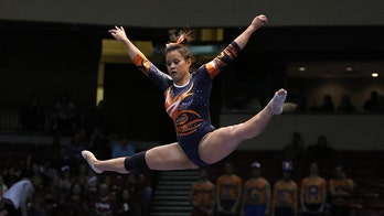 Auburn gymnast who broke both knees during routine walks down aisle for wedding