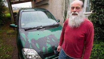 'Devil' caught on camera pouring acid on car