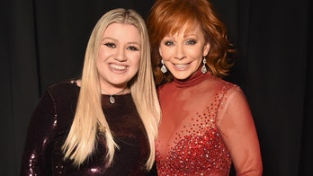 Reba McEntire 'loves to listen' to Kelly Clarkson's Christmas music