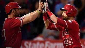 Los Angeles Angels' Jonathan Lucroy, Kevan Smith botch home run high-five celebration