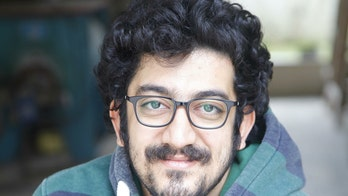 Jailed Iranian musician rebuffs regime's ban by releasing album about war and oppression