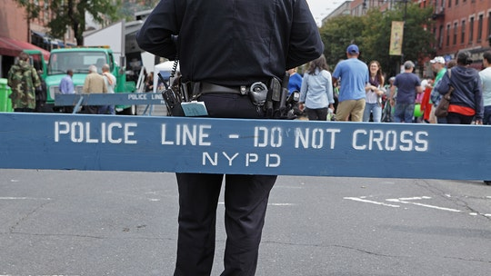 New York City ax attack leaves woman dead, another injured