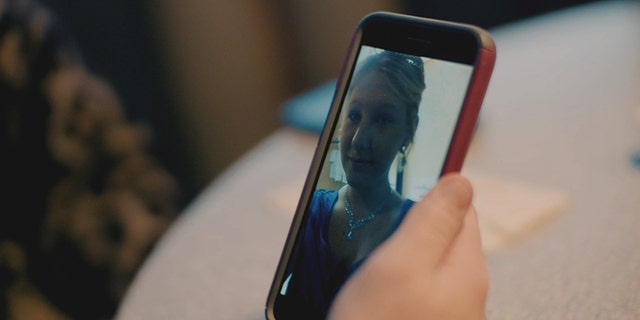 Heather looks back at a selfie she took on her wedding day a few days after her 15th birthday.
