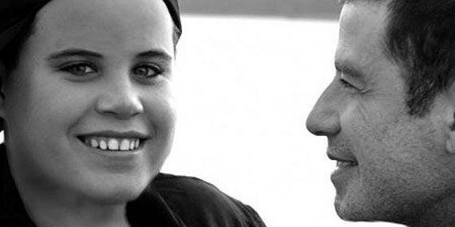 Jett Travolta with father John.