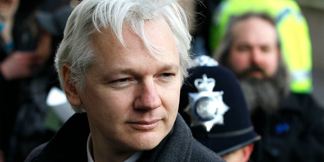FILE - In this Feb. 1, 2012 file photo, Julian Assange, WikiLeaks founder, arrives at the Supreme Court in London. (AP Photo/Kirsty Wigglesworth, File)