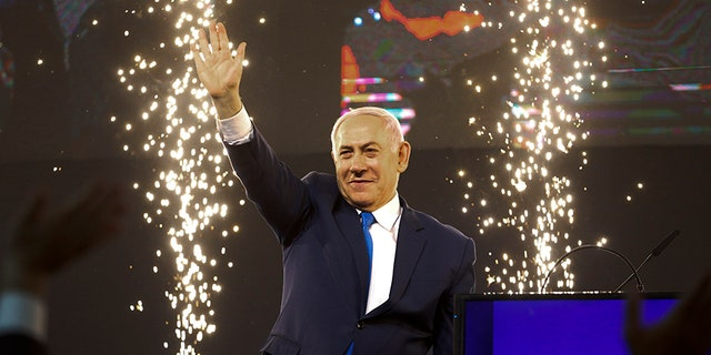 Israel's Prime Minister Benjamin Netanyahu waves to his supporters after polls for Israel's general elections closed in Tel Aviv, Israel, on Wednesday.