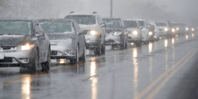 Traffic backs up along 56th Avenue as a spring storm rolls in before the evening rush hour Wednesday, April 10, 2019, in Denver.