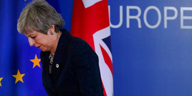 FILE: British Prime Minister Theresa May leaves after addressing a media conference at an EU summit in Brussels.