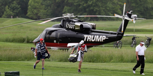 John Nieporte walks past a helicopter on the sixth tee during Round 1 of the Senior PGA Championship at Trump National Golf Club on May 25, 2017 in Sterling, Va. (Photo by Rob Carr/Getty Images)